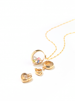 14kt and 9kt gold and rock crystal lockets available in large medium and small round and hearts