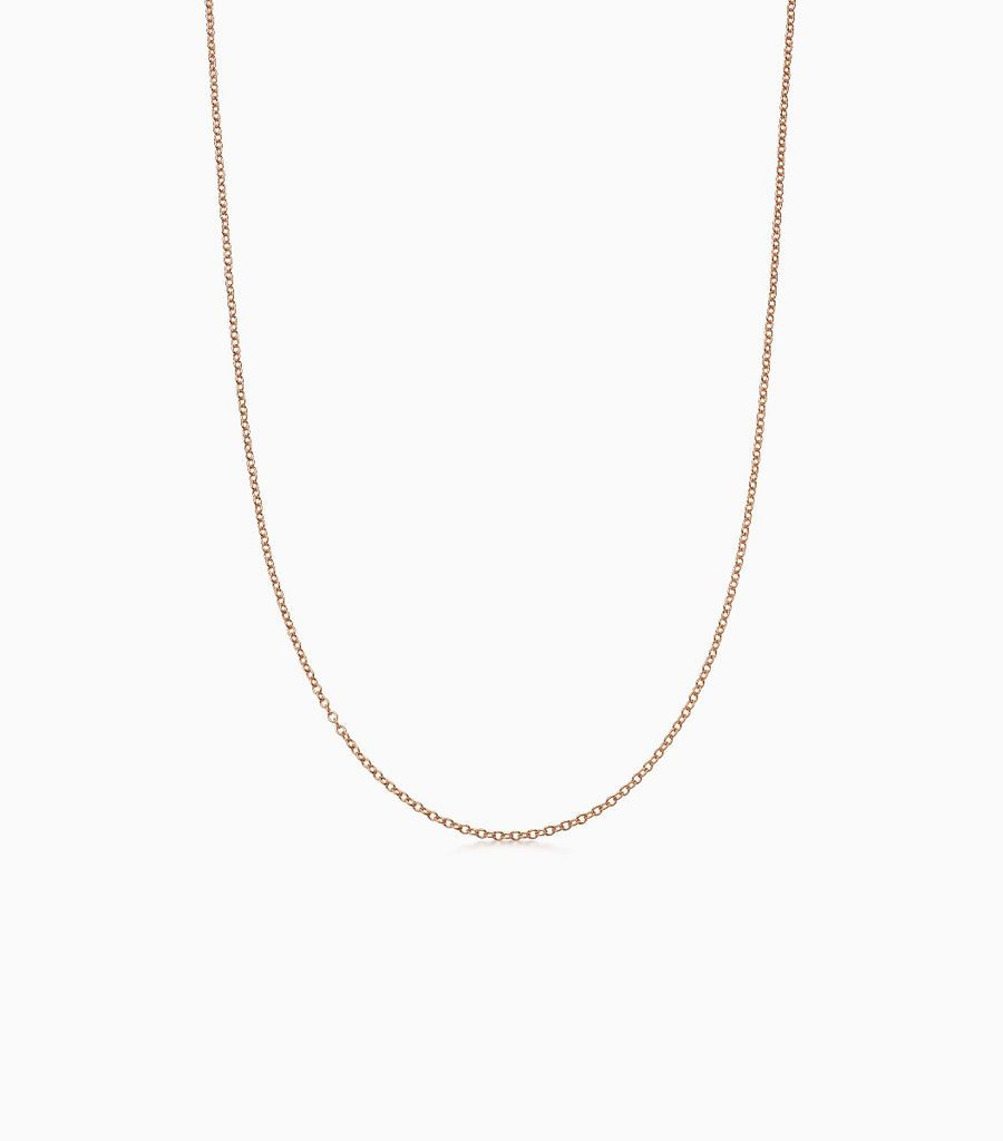 18carat rose gold, fine gauge chain, with an adjustible sliding ball, so that the necklace can be worn at either 16 or 18 inches. Logo disk on the back