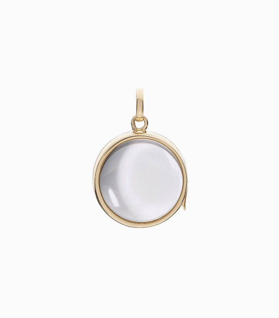 9 carat yellow gold, round locket, set with a bevel edged, crystal glass front and a flat crystal glass back. The locket is designed with a side hindge for secure fastening and measures 18mm