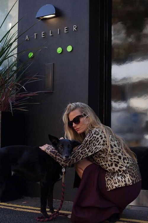 Loquet London's Co-Founder and Creative Director Laura Bailey with her rescue dog Frankie