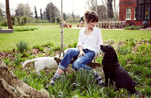 London's Co-Founder and Creative Director Sheherazade Goldsmith with her rescue Dogs Lucky and Patch)